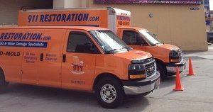 Water Damage Restoration Vans At Commerical Job Location
