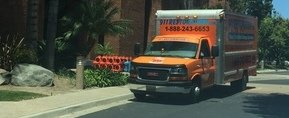 Water Damage Restoration Truck At Job Location